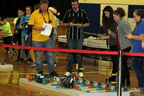 Middle schoolers converged Friday evening at the Bad Axe Middle School for a robotics competition.
