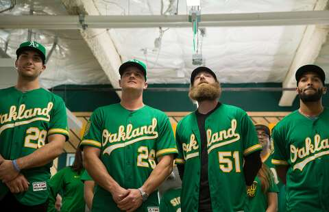 36139d9e9 A s players model new kelly green alternate jerseys - SFGate