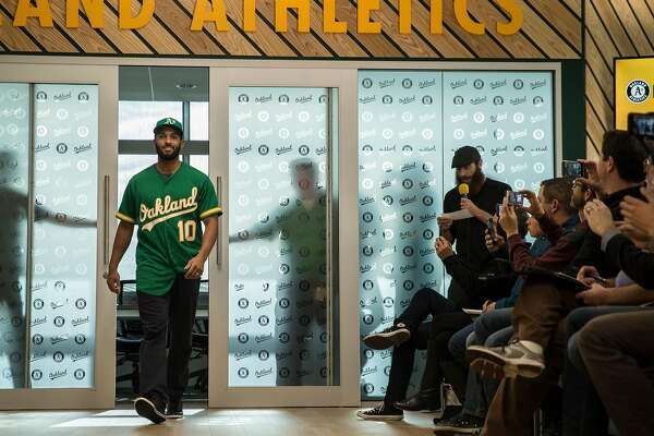 b9c5de5f 3of5Oakland A's infielder Marcus Semien walks down the runway while  sporting the 50th Anniversary edition jersey during a fashion show at the Oakland  A's ...