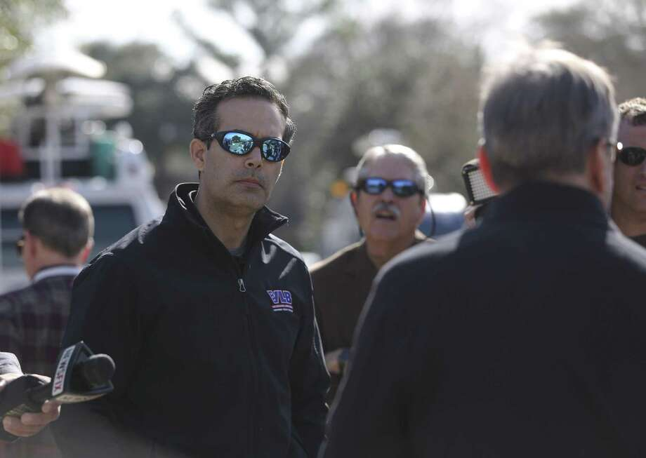 Commissioner of the Texas General Land Office George P. Bush listens to homeowner Scott Short, 66, talking about his Hurricane Harvey flood experience on Chalmette Street on Thursday, Jan. 4, 2018, in League City. Short, who has been living in his house for 22 year, is renovating his flooded house and has received a FEMA RV about two weeks ago. ( Yi-Chin Lee / Houston Chronicle ) Photo: Yi-Chin Lee, Houston Chronicle / Houston Chronicle / © 2018  Houston Chronicle