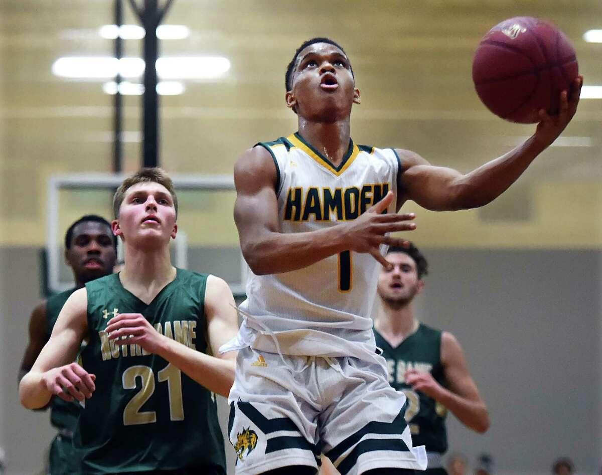 Hamden junior guard Jaylen Ricks scores on Notre Dame-West Haven sophomore guard Zach Laput, Friday, Jan. 26, 2018, at Hamden High School gymnasium. Hamden won, 67-62.
