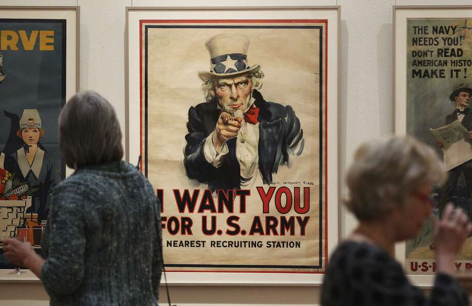 """The familiar iconic image of """"Uncle Sam"""" by illustrator James Montgomery Flagg is seen on display along with other vintage World War I posters at the Central Library Gallery on Oct. 8, 2013. The library opened an exhibit of 40 vintage World War I posters from illustrators commissioned by the U.S. Committee on Public Information to """"build patriotism, raise funds for war bonds, encourage enlistment and increase volunteerism."""" The posters were bequeathed to the library in 1940 by Harry Hertzberg, former Texas state senator. Photo: Kin Man Hui /San Antonio Express-News / ©2013 San Antonio Express-News"""