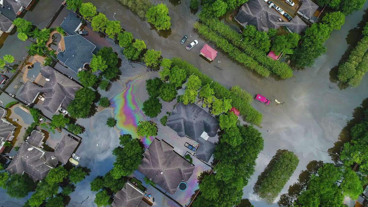Homes in the Cinco Ranch area are surrounded by water from Barker Reservoir, Saturday, September 2, 2017, in Houston. (Mark Mulligan / Houston Chronicle)