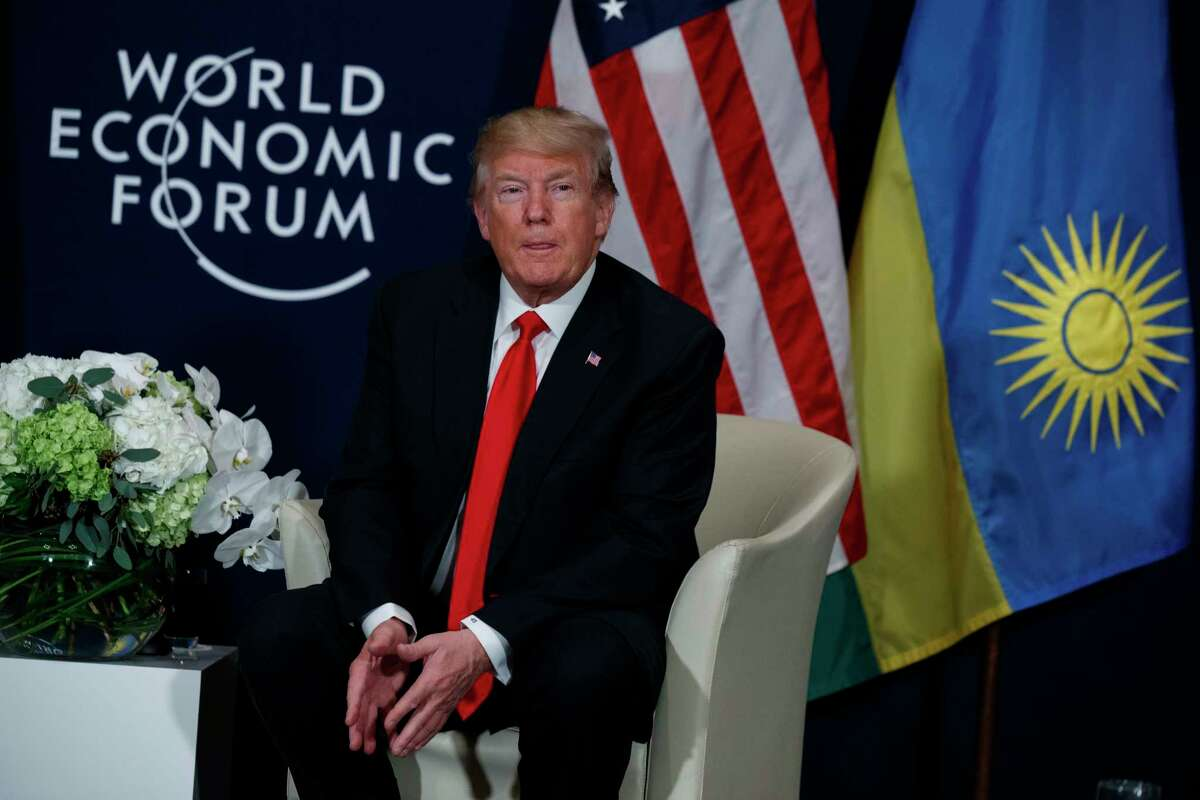 President Donald Trump listens during a meeting with Rwandan President Paul Kagame at the World Economic Forum on Friday, Jan. 26, 2018, in Davos. (AP Photo/Evan Vucci)