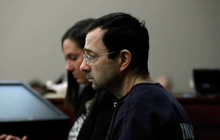 Dr. Larry Nassar listens as a victim gives her impact statement during the seventh day of his sentencing hearing Wednesday, Jan. 24, 2018, in Lansing, Mich. Nassar has admitted sexually assaulting athletes when he was employed by Michigan State University and USA Gymnastics, which is the sport's national governing organization and trains Olympians. (AP Photo/Carlos Osorio)