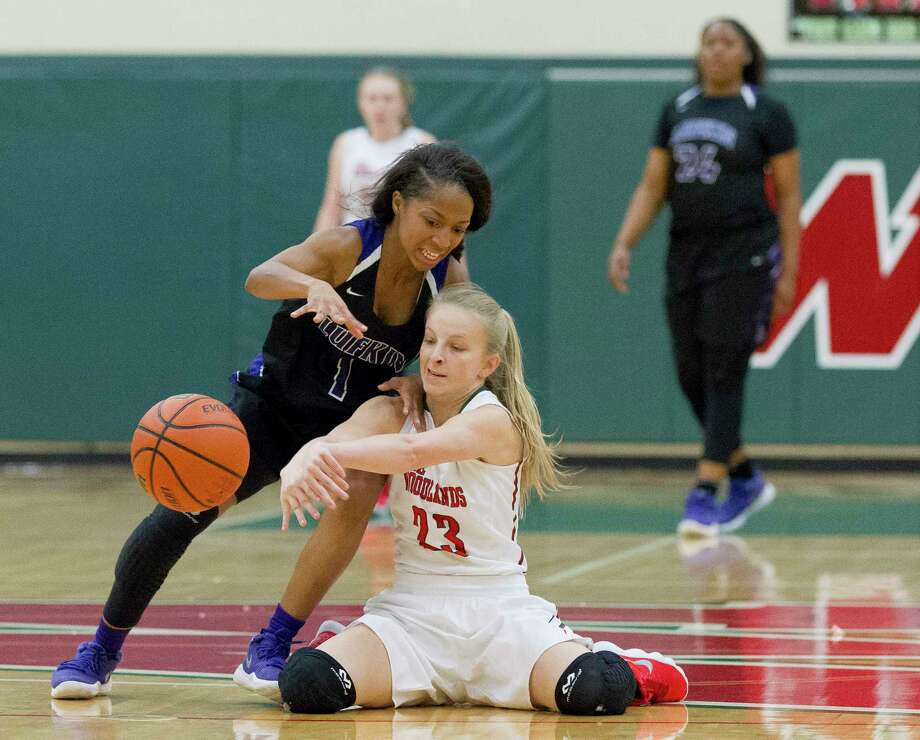 The Woodlands' Bailey Dueitt (23) fights for a loose ball against Lufkin's Je'Dayshia Runnells (1) during the first quarter of a District 12-6A high school basketball game at The Woodlands High School, Friday, Jan. 26, 2018, in The Woodlands. Photo: Jason Fochtman, Staff Photographer / © 2018 Houston Chronicle
