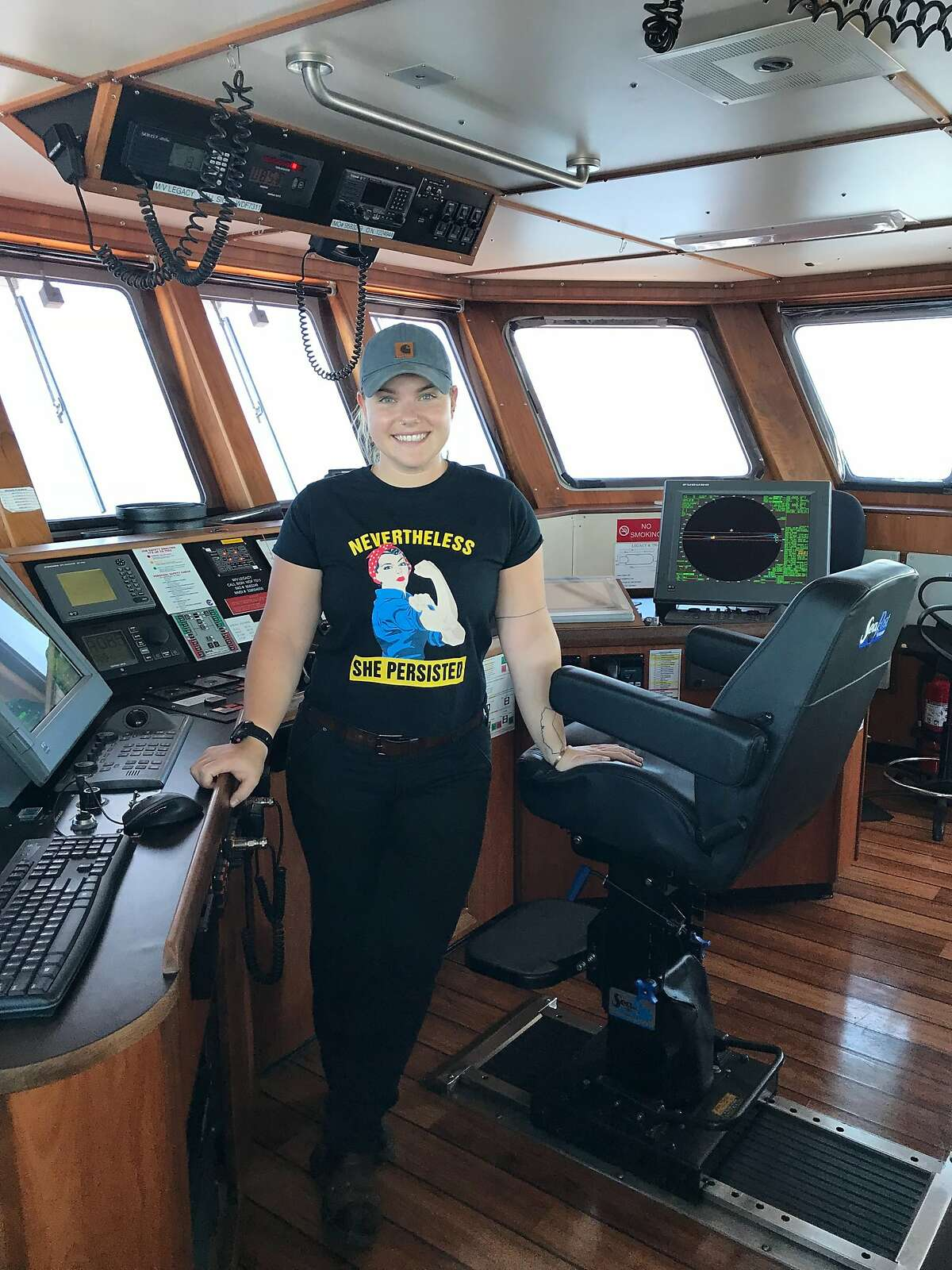 Caption Bonnie Muchnick on the navigating bridge of the tanker Legacy where she is third mate.