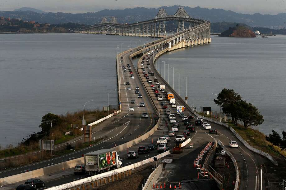The eastbound evening commute traffic across the Richmond-San Rafael Bridge. Plans are in the works to open a third lane on the bridge. Photo: Michael Macor, The Chronicle