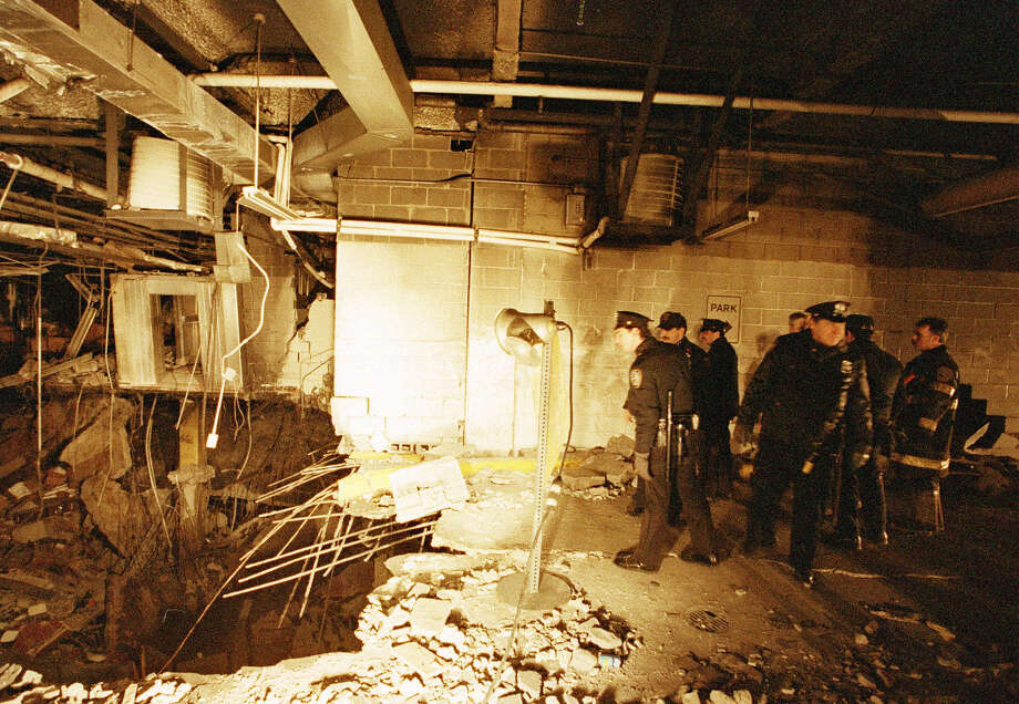 FILE - In this file photo of Feb. 27, 1993, police and firefighters inspect the bomb creator inside an underground parking garage of New York's World Trade Center the day after an explosion tore through it. The National September 11 Memorial & Museum on Friday, Jan. 26, 2018 announced the opening of a special installation to commemorate the 25th anniversary of the 1993 truck bombing of the World Trade Center. (AP Photo/Richard Drew, File) Photo: RICHARD DREW / Copyright 2018 The Associated Press. All rights reserved.