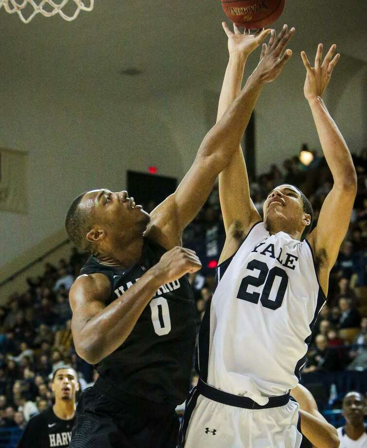 Yale's Paul Atkinson goes up for a shot as Harvard's Chris Lewis defends on Friday night. Photo: John Vanacore / For Hearst Connecticut Media / (c)John H.Vanacore