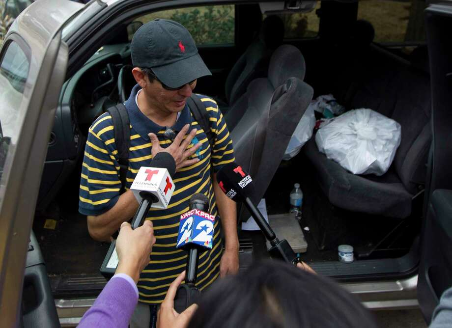 Ernesto Villadares, brother of Ulises Villadares, speaks to the media Friday across from his brother's home where Ulises and his son were bound by a pair of men on Wednesday. The father was taken away by the kidnappers and later killed during an FBI raid Thursday morning. Photo: Jason Fochtman, Staff Photographer / © 2018 Houston Chronicle