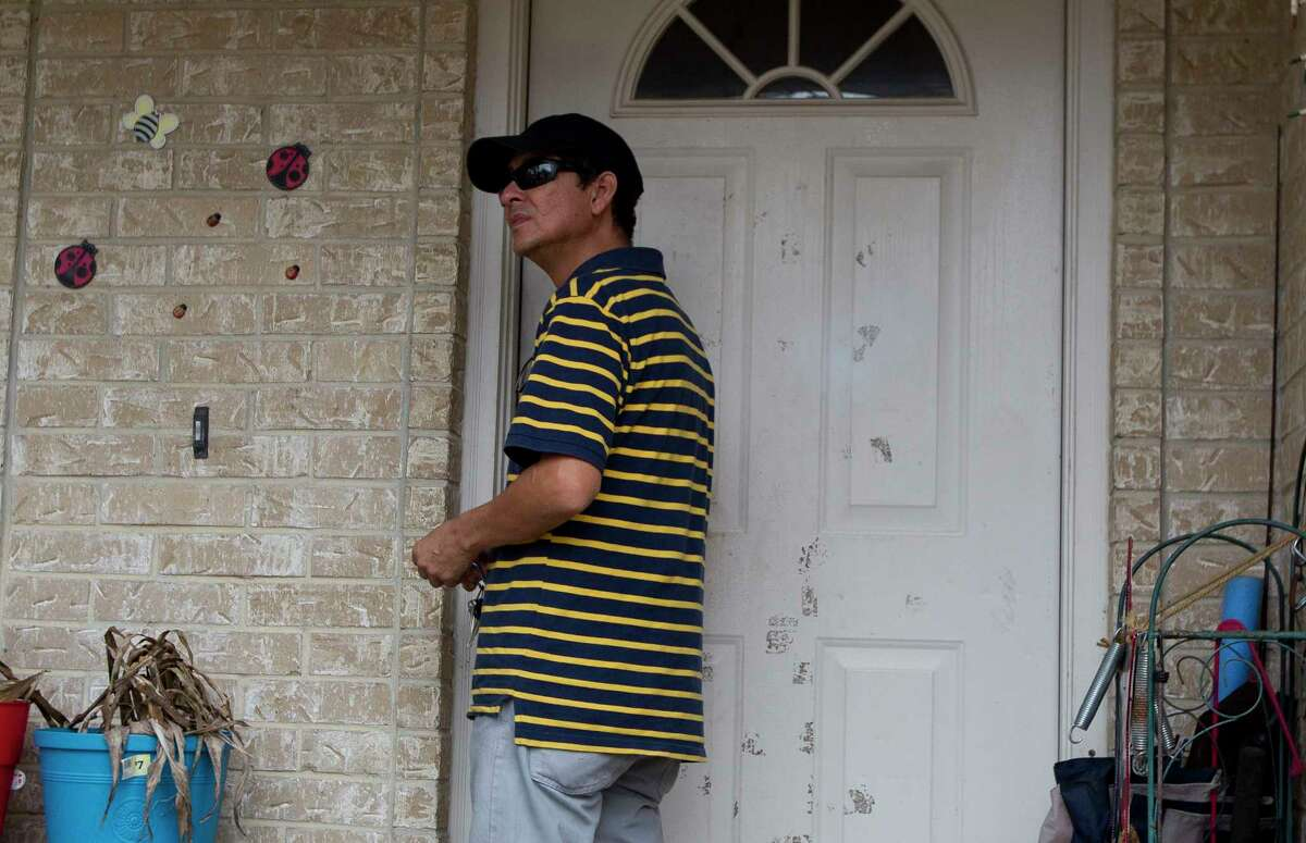 Ernesto Valladares, brother of Ulises Valladares, speaks to the media Friday at his brother's home where Ulises and his son were bound by a pair of men on Wednesday. The father was taken away by the kidnappers and later killed during an FBI raid Thursday morning.