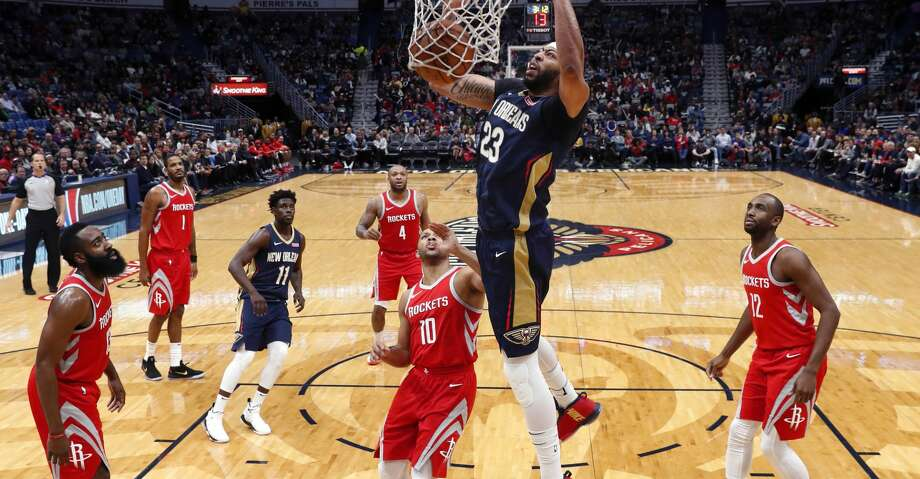 New Orleans Pelicans forward Anthony Davis (23) dunks over Houston Rockets guard Eric Gordon (10) during the first half of an NBA basketball game in New Orleans, Friday, Jan. 26, 2018. (AP Photo/Gerald Herbert) Photo: Gerald Herbert/Associated Press