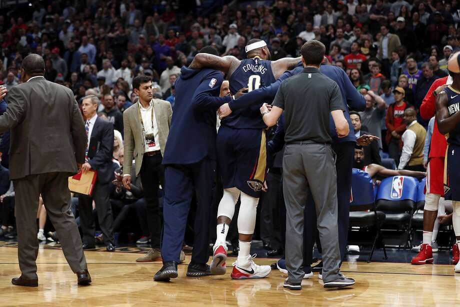 New Orleans Pelicans center DeMarcus Cousins (0) is helped off the court after injuring his left achilles tendon, according to the team, in the second half of an NBA basketball game against the Houston Rockets in New Orleans, Friday, Jan. 26, 2018. The Pelicans won 115-113. (AP Photo/Gerald Herbert) Photo: Gerald Herbert, Associated Press