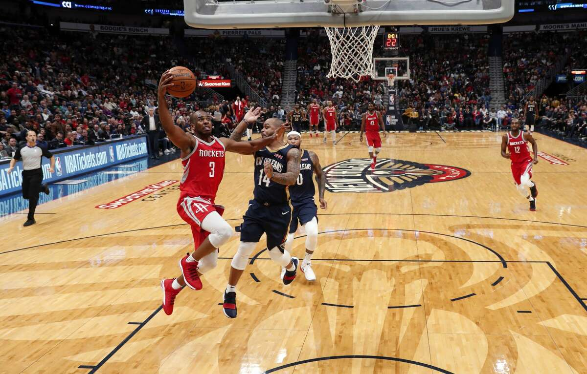 Houston Rockets guard Chris Paul (3) goes to the basket against New Orleans Pelicans guard Jameer Nelson (14) in the second half of an NBA basketball game in New Orleans, Friday, Jan. 26, 2018. The Pelicans won 115-113. (AP Photo/Gerald Herbert)