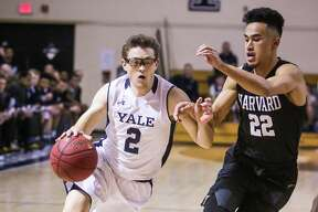 (John Vanacore/for Hearst Connecticut Media) The Yale Bulldogs men's Basketball played host to the Crimson of Harvard Friday January 26, 2017 at Yale's Payne Whitney Gym. Harvard held on to defeat Yale 54-52.