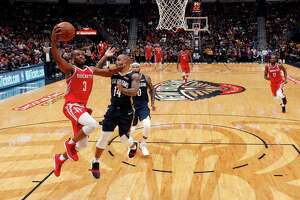 The Rockets' Chris Paul drives to the basket against the Pelicans' Jameer Nelson. Paul was the most productive Rocket with 38 points and eight assists.