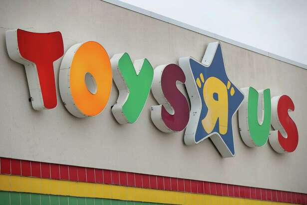 "HIGHLAND PARK, IL - JANUARY 24:  A sign hangs above a  Toys ""R"" Us store on January 24, 2018 in Highland Park, Illinois. The store is one of more than 180 Toys ""R"" Us and Babies ""R"" Us stores scheduled to close. The closings involve about one-fifth of the company's Toys ""R"" Us and Babies ""R"" Us U.S. store fleet. The company recently filed for bankruptcy protection.  (Photo by Scott Olson/Getty Images)"