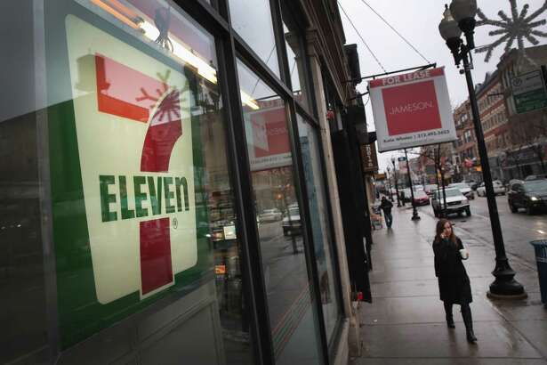 CHICAGO, IL - JANUARY 10:  A pedestrian walks past a 7-Eleven store on January 10, 2018 in Chicago, Illinois. Immigration officials raided nearly 100 7-Eleven stores across the country this morning checking the immigration status of store employees.  (Photo by Scott Olson/Getty Images)