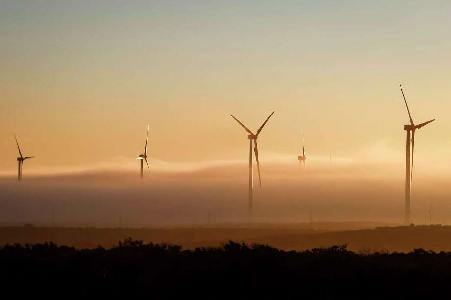 Wind turbines rise from the plains of West Texas in Big Spring. Bottom: Fog engulfs turbines at the BP Sherbino Mesa II Wind Farm in Fort Stockton. Photo: Michael Paulsen / © 2012 Houston Chronicle