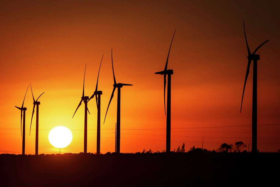 The sun sets behind several wind turbines at the BP Sherbino Mesa II Wind Farm.  Photo: Michael Paulsen, Staff / © 2012 Houston Chronicle