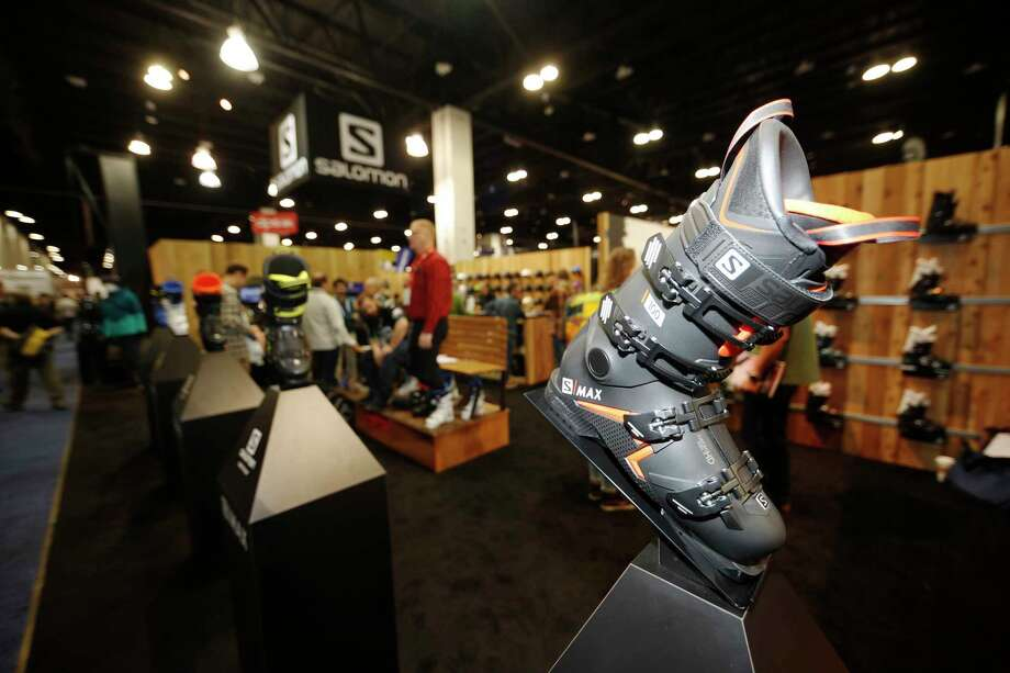 A ski boot appears on a display at the Salomon booth at the opening of the Outdoor Retailers and Snow Show in the Colorado Convention Center, Thursday, Jan. 25, 2018, in Denver. Three floors of all the latest products for outdoor use makes the event the largest U.S. trade show for the outdoor and winter sports industries that represent $887 billion in sales. (AP Photo/David Zalubowski) Photo: David Zalubowski, STF / Copyright 2018 The Associated Press. All rights reserved.