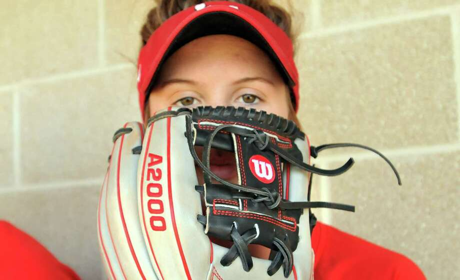 """Lamar Cardinals softball team infielder Savana Guidry holds her Wilson A2000 glove, which she chose with """"H"""" webbing and a darker color scheme. As a shortstop, she went darker so dirt wouldn't show up as easily, compared to outfielders, who can use lighter colors without having to worry about that  (Mike Tobias/The Enterprise)"""