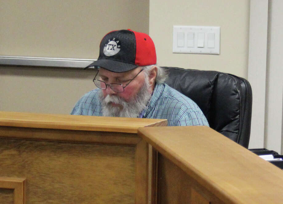 Woodbranch Councilman Mike Kroll expresses concerns with signing a waiver regarding flood damage construction done without permits and its potential long-term harm on residents seeking flood insurance during the Jan. 25 council meeting. Photo: Jacob McAdams