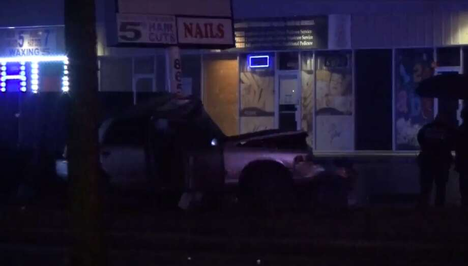 One person died early Saturday after driving into a sign outside of a northwest Houston business, Houston Police said. Police arrived at 9634 N. Houston around 3 a.m. It is not yet known what caused the crash, according to a reporter at the scene. Photo: Metro Video LLC / For The Houston Chronicle