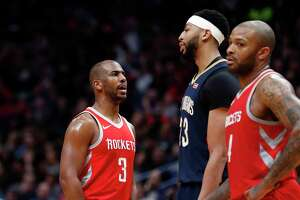 Houston Rockets guard Chris Paul (3) and New Orleans Pelicans forward Anthony Davis (23) exchange words in the second half of an NBA basketball game in New Orleans, Friday, Jan. 26, 2018. The Pelicans won 115-113. (AP Photo/Gerald Herbert)