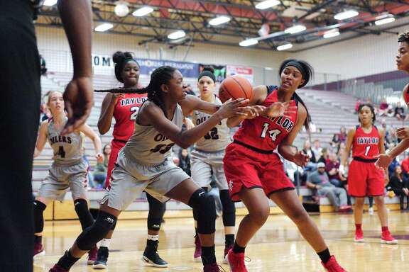 Pearland's De'Yona Gaston (33) was selected the most valuable player of District 23-6A girls' basketball team.