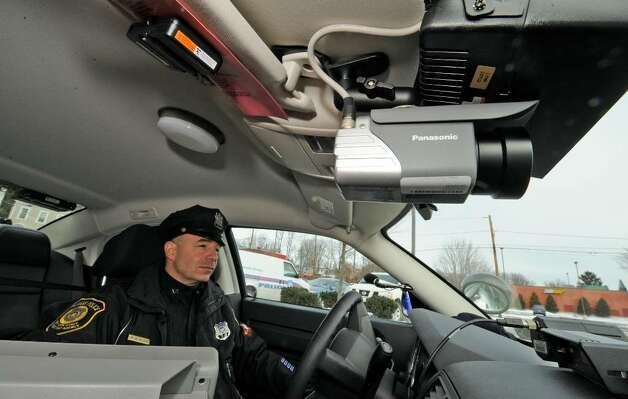 Albany Police Officer William Wilson with the new police camera on board his cruiser.  (Skip Dickstein/Times Union) Photo: Skip Dickstein / 2008