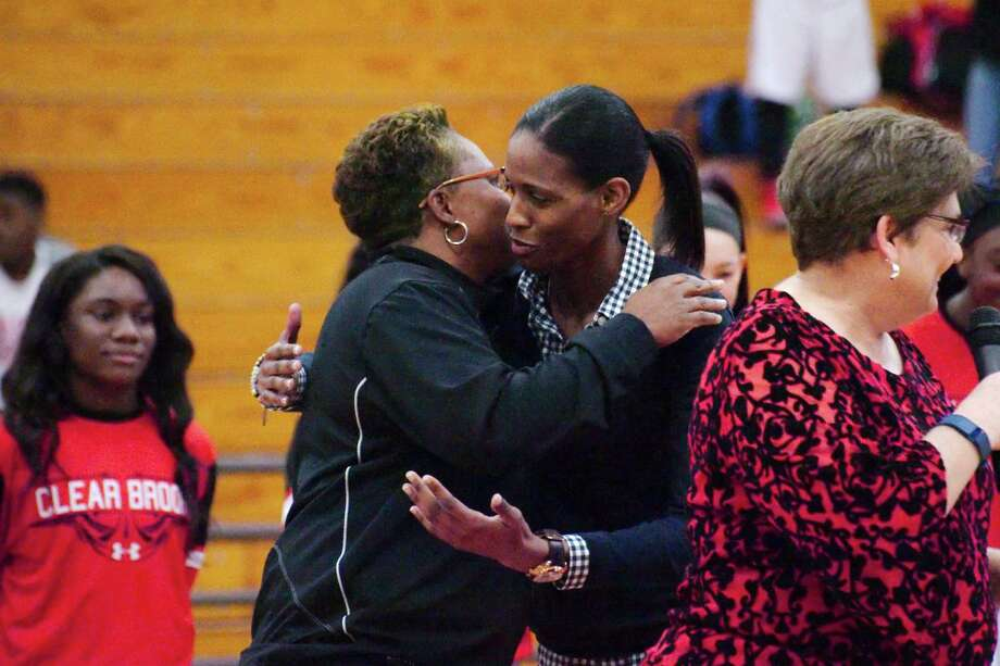 Chameka Scott, a former Baylor University and Clear Brook basketball player, received a hug from former Clear Brook coach and current Clear Springs basketball coach Pam Crawford during a pre-game ceremony in Scott's honor  Feb. 6, 2016. / Kirk Sides