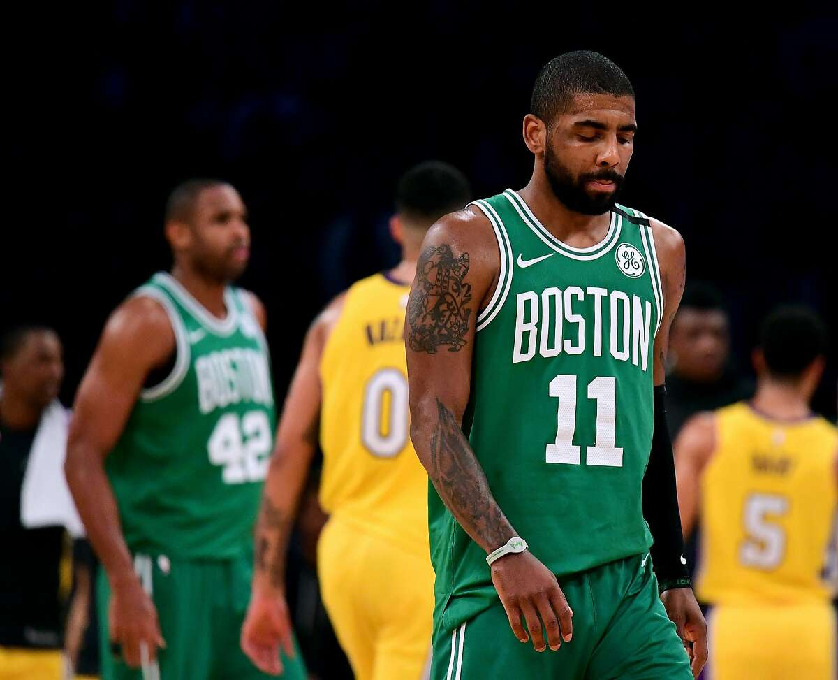 LOS ANGELES, CA - JANUARY 23: Kyrie Irving #11 of the Boston Celtics reacts as he heads back to the bench after a timeout trailing the Los Angeles Lakers during a 108-107 Laker win at Staples Center on January 23, 2018 in Los Angeles, California. (Photo by Harry How/Getty Images)