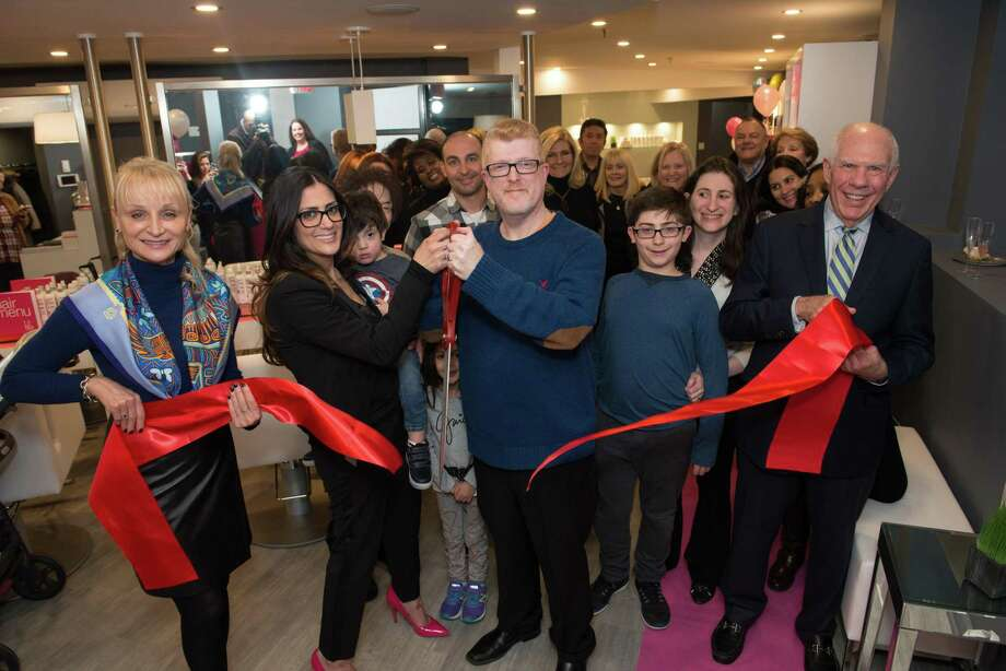 Greenwich Chamber of Commerce President Marcia O'Kane, left, owners Marianne and Bruce Hammer and Selectman Sandy Litvak, right, cut the ribbon at the Grand Opening of Blo, a blow-dry bar on Greenwich Avenue. Photo: Contributed Photo /