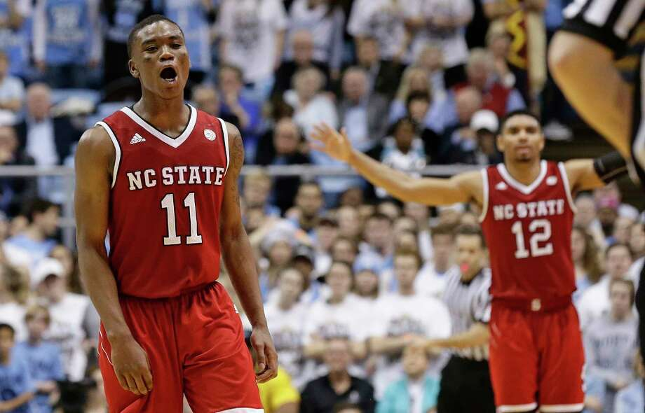North Carolina State's Markell Johnson (11) and Allerik Freeman (12) celebrate as time expires in an NCAA college basketball game against North Carolina in Chapel Hill, N.C., Saturday, Jan. 27, 2018. North Carolina State won 95-91. Photo: Gerry Broome, AP / Copyright 2018 The Associated Press. All rights reserved.