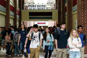 Students walk the hallway between classes during the first day for students returning to school at The Woodlands College Park High School on Tuesday, Sept. 5, 2017, in The Woodlands. Students in the Conroe Independent School District returned to classes for the first time since Hurricane Harvey hit the area. ( Brett Coomer / Houston Chronicle )