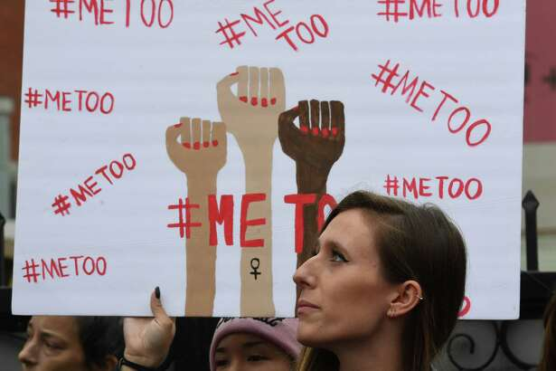"""Victims of sexual harassment, sexual assault, sexual abuse and their supporters protest during a #MeToo march in Hollywood, California on November 12, 2017. Several hundred women gathered in front of the Dolby Theatre in Hollywood before marching to the CNN building to hold a rally. / AFP PHOTO / Mark RALSTONMARK RALSTON/AFP/Getty Images ORG XMIT: """"#MeToo"""""""