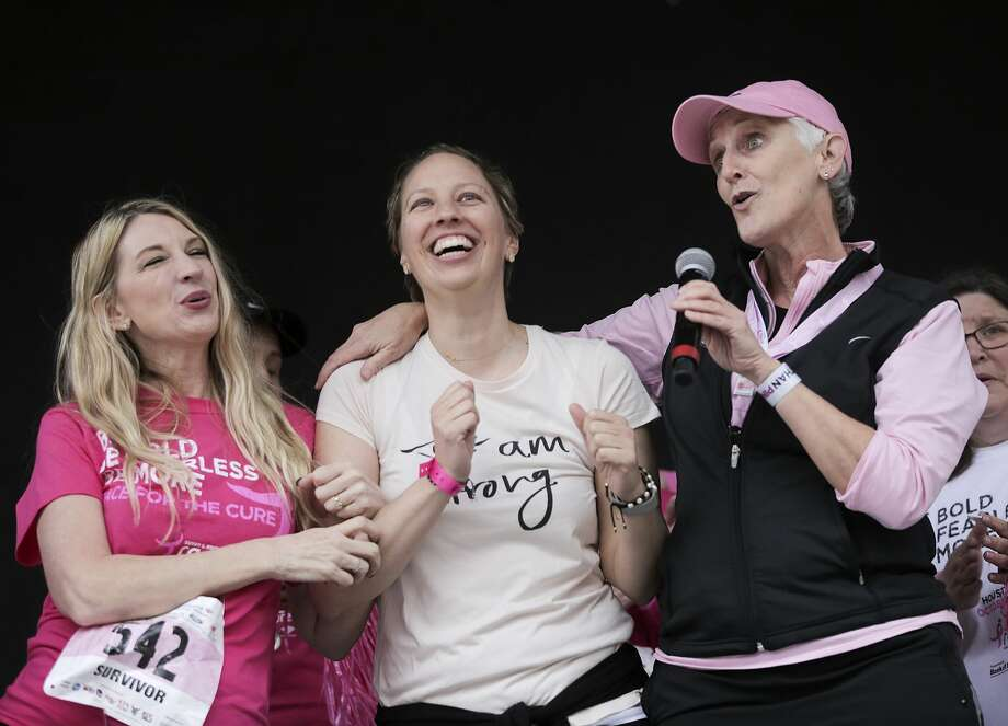 "Breast cancer survivors sing ""I Will Survive"" on stage after the Susan G. Komen Race for the Cure at Sam Houston Park  on Saturday, Jan. 27, 2018, in Houston. The event, which is traditionally in October, was rescheduled because of Harvey. ( Elizabeth Conley / Houston Chronicle ) Photo: Elizabeth Conley/Houston Chronicle"