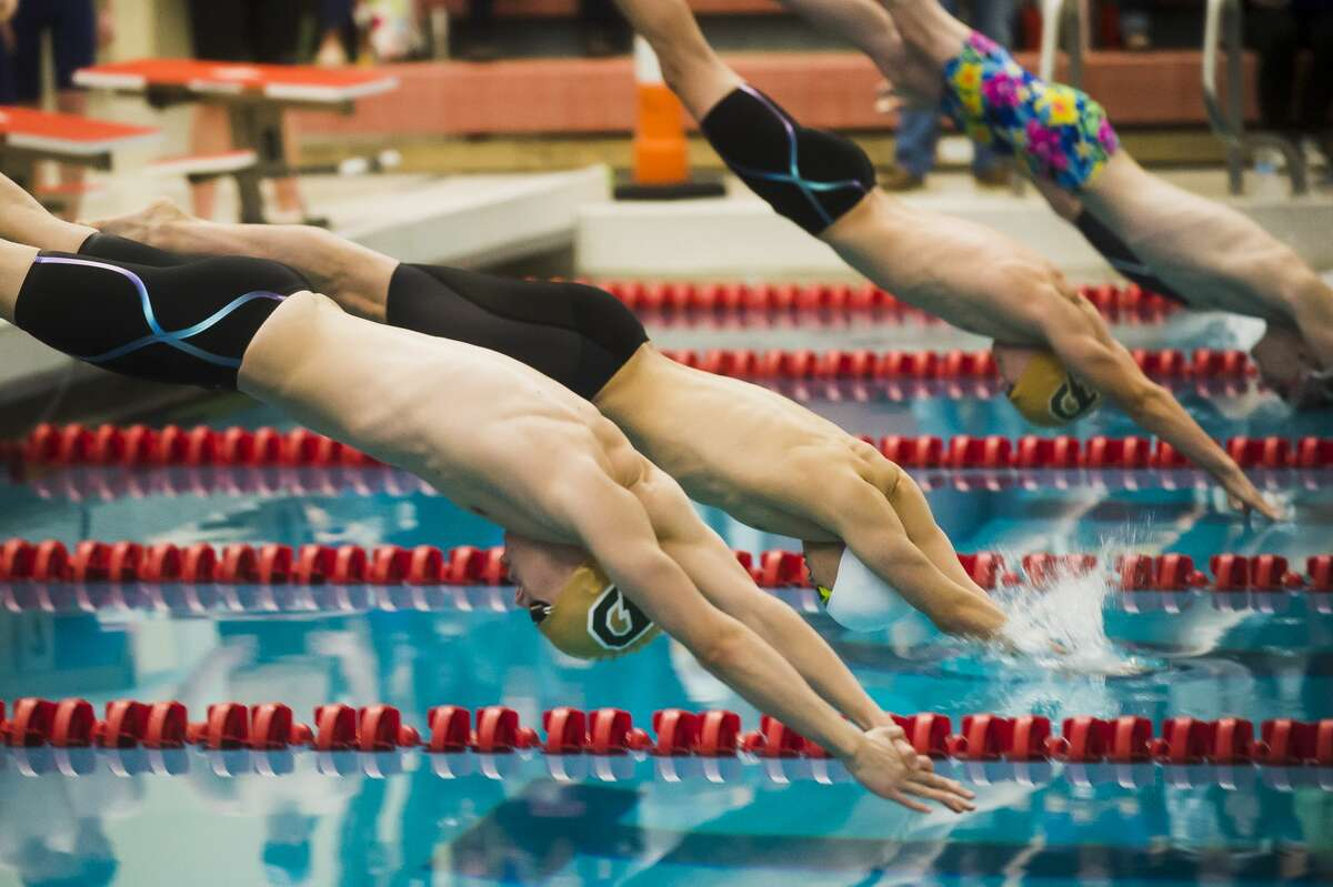 Dow senior Jacob Krzciok, left, competes in the 200 yard freestyle relay during the Tri-Cities boys' swim championships on Saturday, Jan. 27, 2018 at Saginaw Valley State University. (Katy Kildee/kkildee@mdn.net)