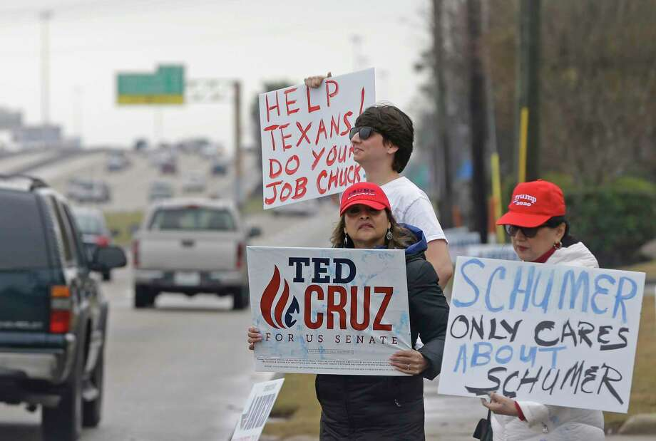 Protesters stand outside the Houston Marriott South, 9100 Gulf Freeway,    Saturday, Jan. 27, 2018, in Houston where U.S. Senate Majority Leader Chuck Schumer was scheduled to be at a fundraiser for several Democratic Senate incumbents and candidates. Photo: Melissa Phillip, Houston Chronicle / © 2018 Houston Chronicle