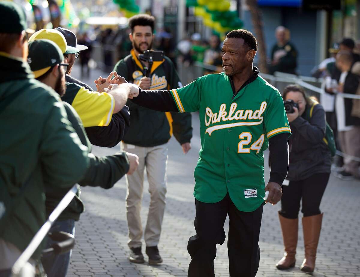 A's Hall of Famer Rickey Henderson greets the crowd as he arrives for Oakland Athletics Fan Fest at Jack London Square on Saturday, Jan. 27, 2018 in Oakland, Calif.