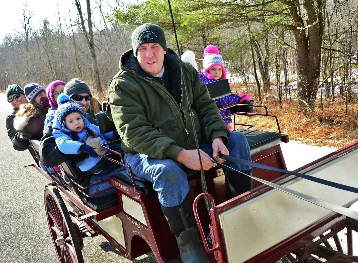 Troy Bapp of Kingsbury takes visitors on a horse-drawn wagon ride during Saratoga National Historical Park's 23rd Annual Frost Faire Saturday Jan. 27, 2018 in Stillwater, NY. (John Carl D'Annibale/Times Union)