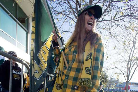 Dana Morgan of Pinole, Calif. shows off her A's tattoos during Oakland Athletics Fan Fest at Jack London Square on Saturday, Jan. 27, 2018 in Oakland, Calif.