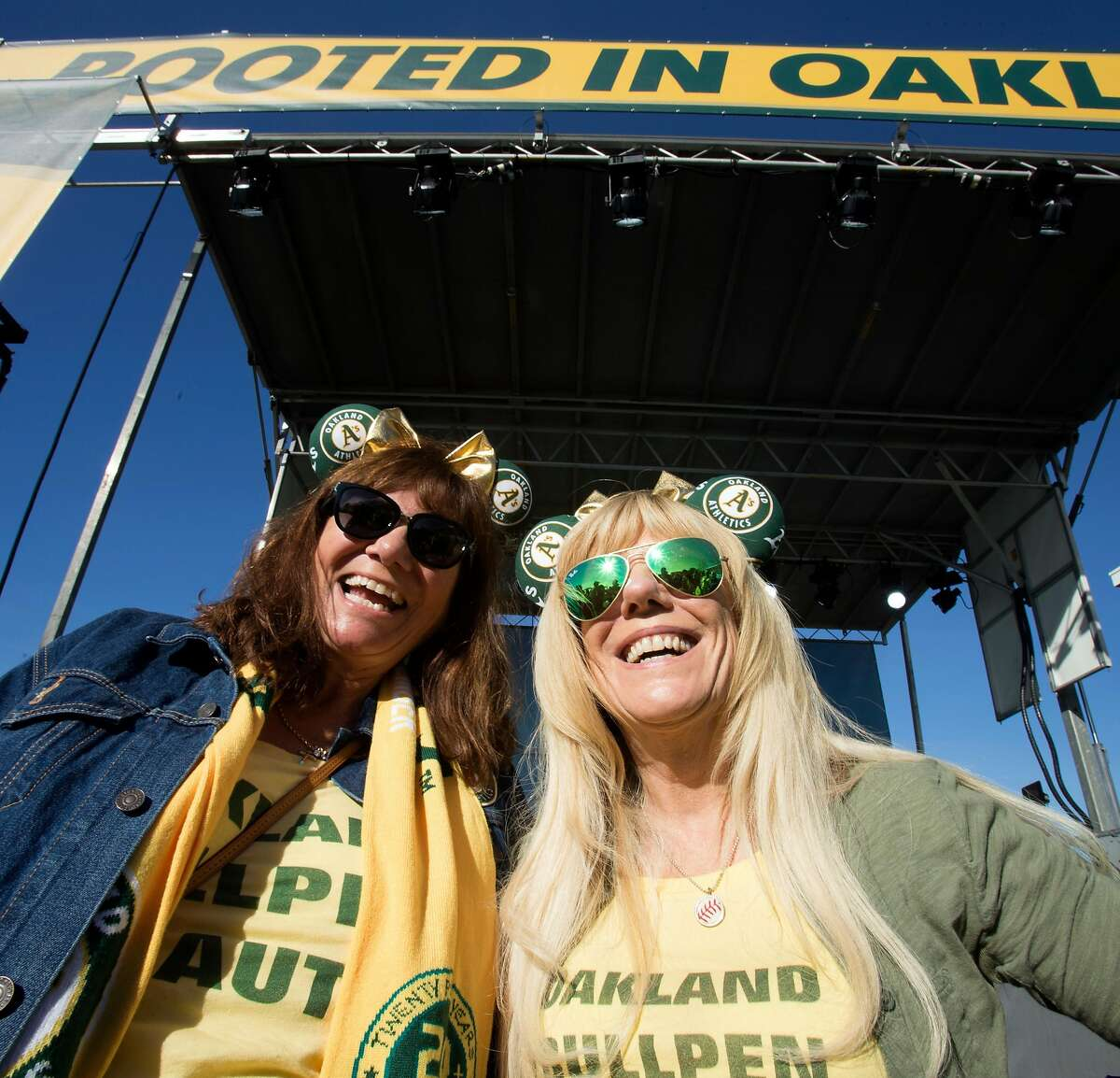 Alicia Puccinelli of San Jose, left, and Ane Smith of Livermore, Calif show off their A's paraphernalia during Oakland Athletics Fan Fest at Jack London Square on Saturday, Jan. 27, 2018 in Oakland, Calif.