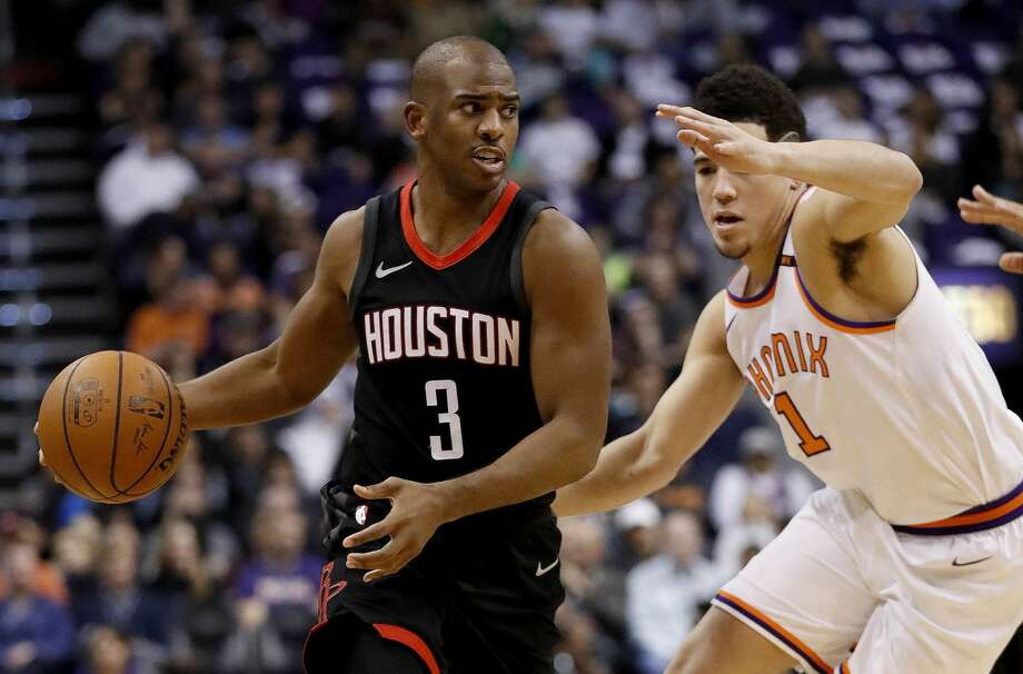 Houston Rockets guard Chris Paul (3) drives against Phoenix Suns guard Devin Booker (1) during the first half of an NBA basketball game, Friday, Jan. 12, 2018, in Phoenix. (AP Photo/Matt York) Photo: Matt York/Associated Press