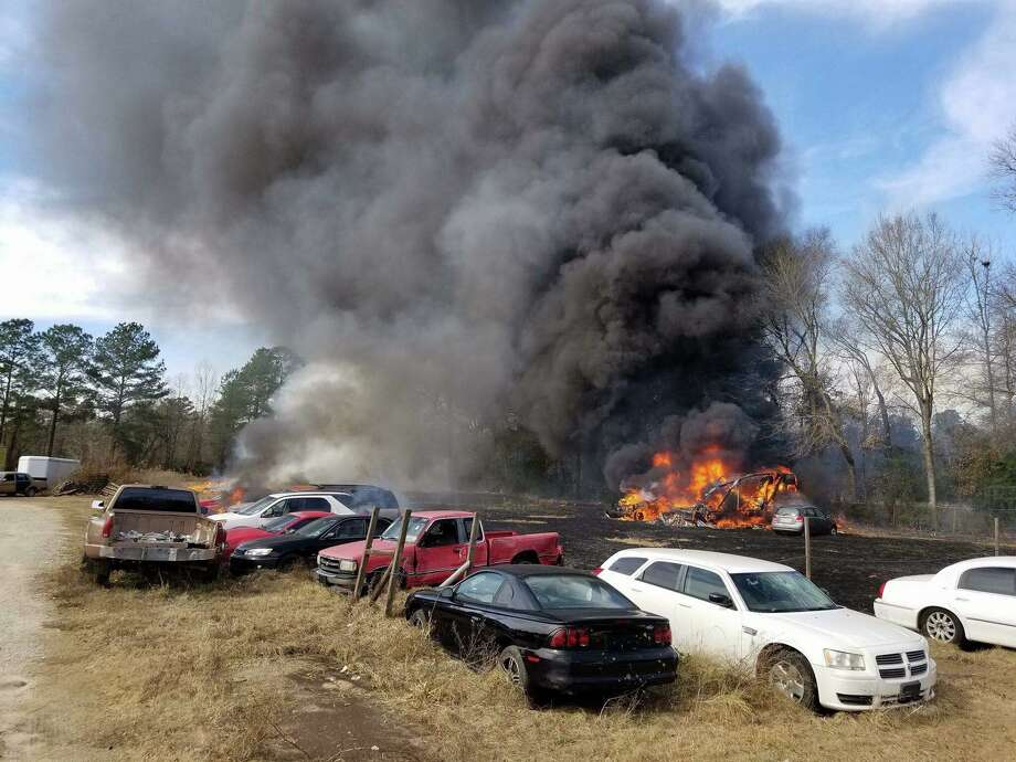 Fire fully engulfs an RV on the 26700 block of  FM 1485 East in New Caney Thursday. The fire is believed to have originated near the RV before spreading across the grass to other nearby vehicles. Photo: Submitted