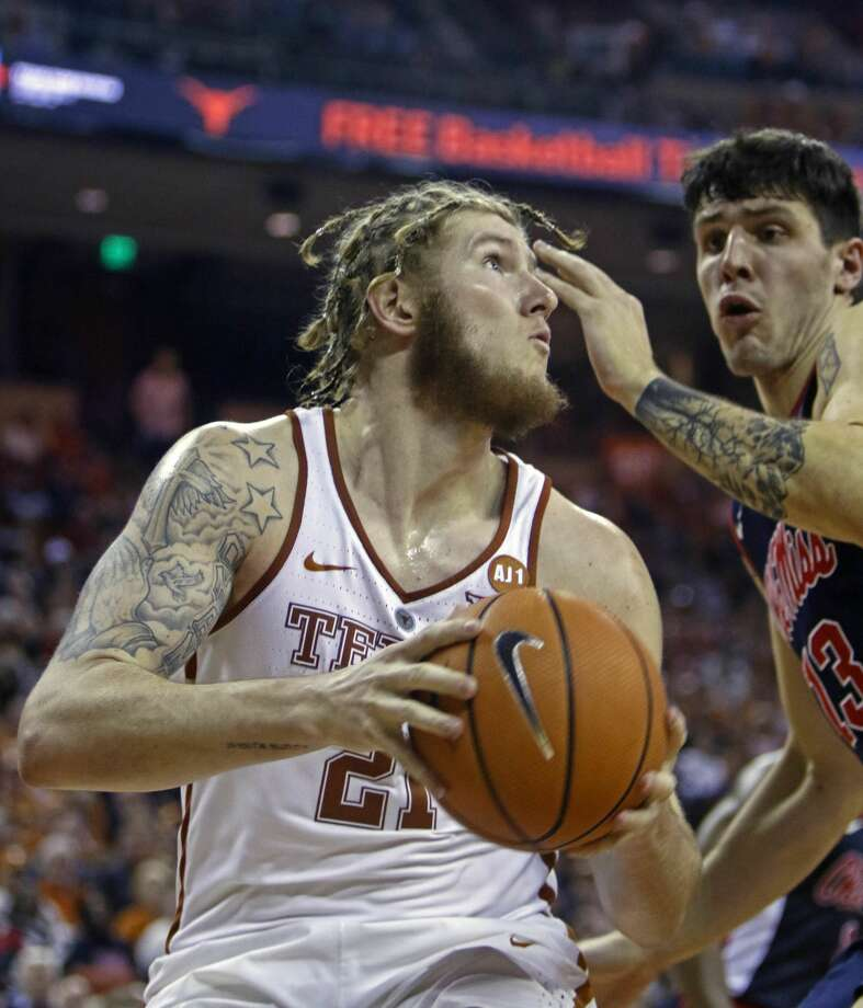 Texas forward Dylan Osetkowski, left, looks to shoot against Mississippi center Justas Furmanavicius, right, during the second half of an NCAA college basketball game, Saturday, Jan. 27, 2018, in Austin, Texas. Texas won 85-72. (AP Photo/Michael Thomas) Photo: Michael Thomas/Associated Press