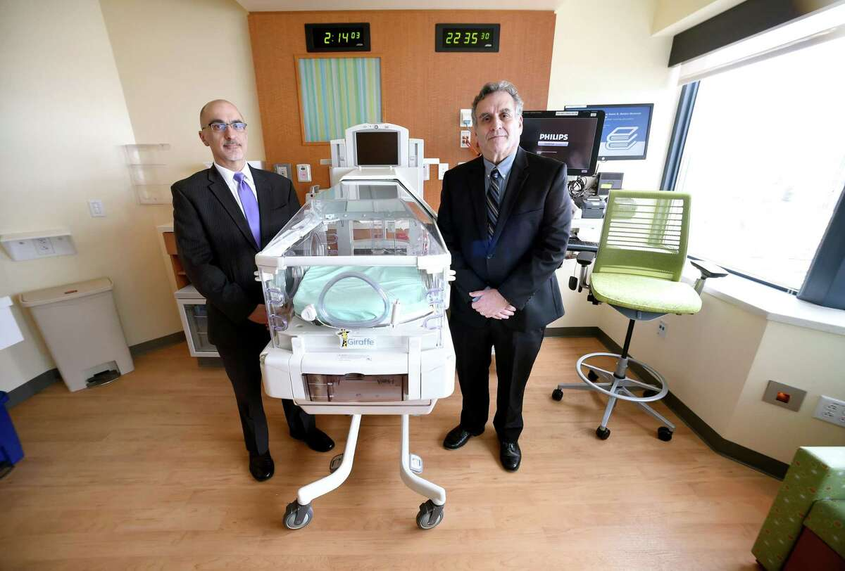 Dr. Matthew Bizzarro, left, and Dr. Mark Mercurio are photographed in one of the new Neonatal Intensive Care Unit rooms at Yale New Haven Children's Hospital. The unit is scheduled to open on Tuesday.