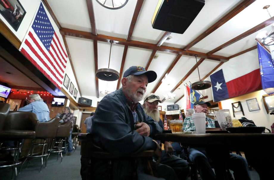 """Korean War veteran William """"Mr. Bill"""" Glass, 85, at the VFW Post 4709 in Conroe, says he likes what he sees in President Donald Trump. """"He's not a politician. He's a businessman. And that's what we needed,"""" said Glass, echoing many Trump supporters. Photo: Karen Warren, Staff / © 2018 Houston Chronicle"""